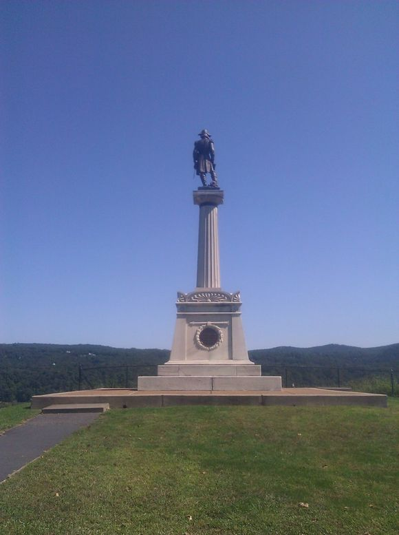 Kosciuko Statue from front and side.jpg