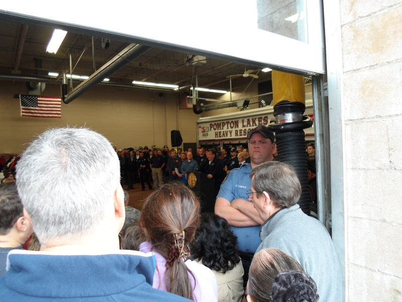 Another picture of Governor Christie in front of Pompton Lakes Heavy Rescue Truck