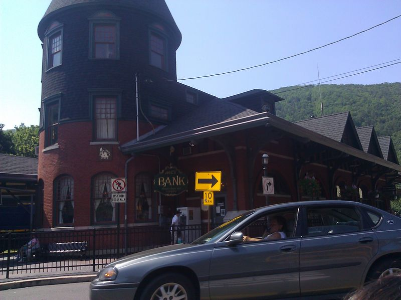Scenic Train Station and Bank with old Mauch Chunk sign labelling stop